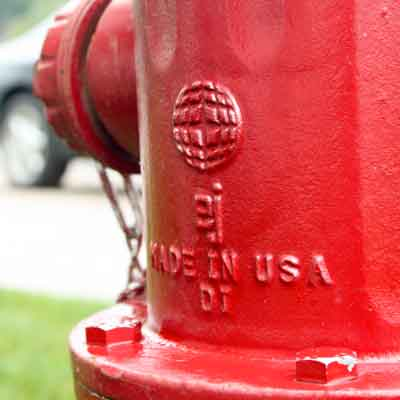 Red WaterMaster 5BR250 fire hydrant bonnet close up with EJ logo